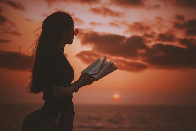 a girl is reading a book
