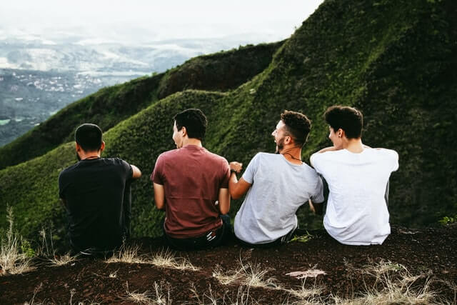 4 boys are sitting down